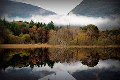Mucross House, Killarney (Bren Lynch Photography) Tags: trees ireland cloud house mist lake reflection fog grey still scenery kayak colours kerry muckross canoe killarney muckrosshouse 600d