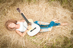 Happy girl with guitar lying on grass in meadow. (Konstantin Yolshin) Tags: autumn summer vacation portrait people musician music woman white nature girl beautiful beauty smile grass smiling female relax outside happy person one holding closed pretty day hand guitar outdoor sleep dream young straw free lifestyle dry down jeans musical barefoot instrument land leisure relaxation lying carefree enjoyment hold lay laying