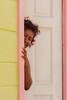 Shy girl (Eric R Porcher) Tags: door light shadow people house colors girl smile canon shy teen unknown tropical timid 50d impressedbeauty flickrdiamond mygearandme