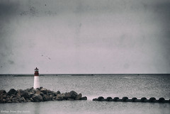 View over the sea (- Man from the North -) Tags: sea lighthouse water finland pier ostrobothnia