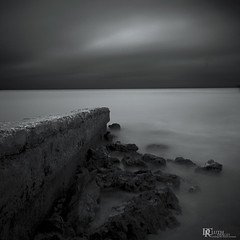 Bradenton Beach Breaker (Dennis Cluth) Tags: longexposure beach monochrome florida fineart coastal bradentonbeach