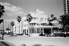 Art Deco Hotel (Phillip Pessar) Tags: ocean camera bw white black art film beach analog hotel us store florida zoom kodak miami terrace district infinity tx trix north places olympus x historic thrift shore 400 register tri deco 70