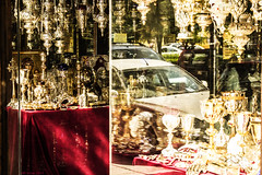 Gods and masters. (df-stop.) Tags: street urban reflection window car shop canon power traffic control religion greece thessaloniki cloth capitalism timeless heard acceptance chalice routine orthodoxchurch established makedonia vitrin egnatia  macedoniagreece eurocrisis dfstop