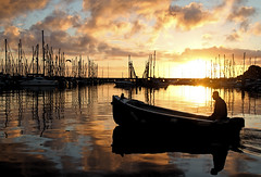 Brixham sunrise (NikNak Allen) Tags: sea sky man water clouds reflections harbor boat seaside fishing devon masts brixhamsunrise