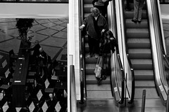 Waiting on escalator. (Ph. Hahn) Tags: life street old city people bw black male female germany person alone escalator streetphotography olympus menschen leben omd dokumentation schwarzweis em5 munster strasenfotografie