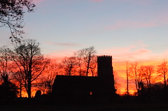 The silhouette of Henstead church against a strong sunset (Kirkleyjohn) Tags: sunset church silhouette atardecer countryside suffolk sonnenuntergang pôrdosol coucherdusoleil hensteadchurch stmaryhenstead