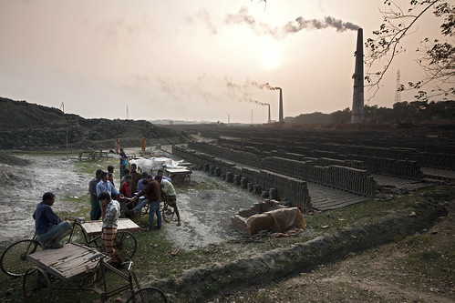 Taking a break from toiling at the brick field in Khulna, Bangladesh. Photo by Felix Clay/Duckrabbit.