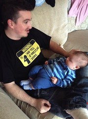 """In his """"Warning"""" shirt, Ross Gardner teaches his young one the way of the heel."""