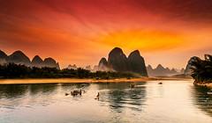 Yangshuo_4 (Santo(Thanks for 2 Million++views!!)) Tags: china sunset sky mountains nature water clouds river landscape evening boat natural guilin yangshuo riverli mygearandme mygearandmepremium infinitexposure