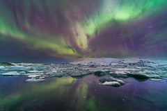 'Lagoon Lightshow' - Jökulsárlón, Iceland (Kristofer Williams) Tags: jokulsarlon aurora ice lagoon glacial icebergs glaciallagoon auroraborealis northernlights water reflections stars night sky nightscape landscape