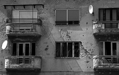 signs #2 (matthew_nan) Tags: life windows people blackandwhite white signs black building window sign living war terrace live sarajevo balcony bosnia herzegovina bullet bullets bosniaherzegovina bosniaandherzegovina