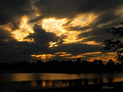 Sunset on the Storm (Blanca Rosa2008 +3,500,000 Views Thanks to All) Tags: sunset sky naturaleza lake nature yellow clouds reflections landscape fire golden canonpowershot sunsetmiami canonpowershotsd880is parksmiami landscapemiami zstincer silhouettestree