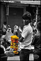 Flower saler (me&art) Tags: flowers woman india man kids lotus streetlife peoples maharashtra mumbai dadarflowermarket