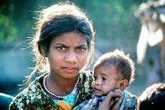 Teen Mother, Mumbai, India (Vern Krutein) Tags: people woman india lady female mom asian person women asia child poor impoverished hunger bombay maharashtra mumbai starvation destitute malnutrition subsistence motherly motherwithchildren thirdworldpoverty pmcv01p0702