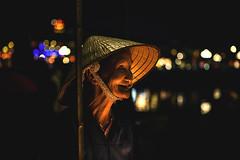 Vietnam (♫♪♭Enricodot ♫♪♭ an apple a day....) Tags: enricodot vietnam light bokeh lights woman night women seller iso canon 5d street streetphotographer portrait portraits people