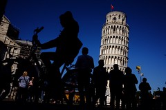 Man on bicycle and people (marcellopantaloni) Tags: leaningtower italy pisa streetphotography street tower siluette