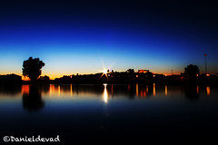 Fallen Star (Danieldevad) Tags: light sunset espaa lake reflection luz lamp silhouette night landscape lago star noche town spain dusk paisaje fallen reflejo flare lampara silueta estrella anochecer trujillo extremadura caceres danieldevad