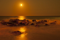 Golden Moon [EXPLORE] (Moniza*) Tags: ocean longexposure sunset sea sky moon seascape reflection beach nature water silhouette night clouds sunrise landscape dawn golden newjersey twilight sand nikon rocks waves nj illumination rocky luna explore nightlight bluehour belmar jerseyshore avon celestial bradleybeach oceangrove d90 explored moniza