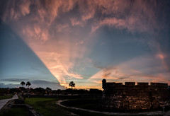 St. Augustine Sunset (Ed Rosack) Tags: pink blue sunset sky panorama usa cloud color tree weather sign architecture landscape cityscape florida fort dusk path military palm manmade features sunbeam staugustine armedforces