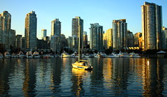 City Sail (Andrew Cier) Tags: ocean blue sunset orange water yellow vancouver sailboat landscape harbor boat dock cityscape towers sail waterscape