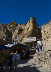 Carved Home In The Village Of Kandovan, Iran (Eric Lafforgue) Tags: city travel roof sky people sculpture house mountain colour history tourism rock vertical architecture outdoors photography design town asia day village iran middleeast bluesky carving valley environment weathered copyspace groupofpeople troglodyte cultures arid eroded rockformation kandovan traveldestinations colorimage  buildingexterior agingprocess nonurbanscene  islamicrepublicofiran  iro  builtstructure residentialstructure westernasia chandovan humansettlement  iran0272