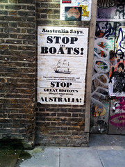 Stop the Boats Save Australia from Genocide poster, Fashion Street, Brick Lane, Tower Hamlets, London, UK (gruntzooki) Tags: uk london sign poster australia bricklane racism towerhamlets