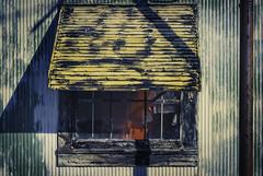 Awning (hutchphotography2020) Tags: window yellow metal awning photography nikon rust peeling shadows surface weathered siding peelingpaint corrosion peeled httphutchphotography2020wordpresscom