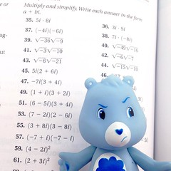 Ugh, algebra homework. (Q. Q. Kachoo) Tags: toys ugh squareformat carebears homework bleh algebra grumpybear iphoneography instagramapp