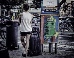 She sells sanctuary (lanier67) Tags: street travel summer urban woman girl pose germany advertising poster evening pants song itunes cult wait shorts heidelberg playlist suitcase sanctuary sells
