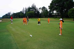 DSC00331fr (Mangiwau) Tags: girls orange golf indonesia asian course jakarta fantasy babes golfing raya fairway cart buggy baju indonesian caddy gading caddie rabu lapangan cewek jakindo
