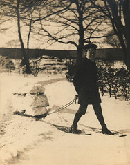 A young boy with a Sled in the Snow (Tyne & Wear Archives & Museums) Tags: festive victorian snow family tradition cold leisure joy digitalimage blackandwhitephotograph socialhistory northeastofengland unitedkingdom avictorianchristmas youngboy child male sled view glimpse festiveseason change progress christmas invention 19thcentury victorianerachristmas victorianera medievaltraditions transformation evergreens food queenvictoria princealbert christmastree royalfamily home house wall roof sky tree branch vegetation shadow daylight rope boot socks shorts coat hat jumper smiling attentive walking slope grain blur mark debris germantradition germanborn childhood britain moderndaytraditions victoriansociety gutter land ground fascinating interesting unusual engaging winter