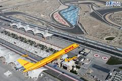 DHL 757 & Extra Formation - Bahrain International Circuit (KarlADrage) Tags: dhl bahraininternationalcircuit geeek boeing757 extra300 chrisburkett extra200 adrianwillis bahraininternationalairshow gexil a9cdhe bias2014
