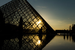 Sunset through glass (Nils Croes) Tags: sunset sky sun paris reflection water canon reflections louvre 1740 clearsky 60d