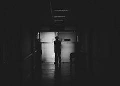 The Waiting Game (Rockwell Peligro Mock) Tags: blackandwhite hospital dark birth eerie waitingroom