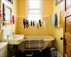 Old Apartment Bathroom (Kurt Kramer) Tags: bathroom colorful yellow socks laundry vintage unchanged bathtub