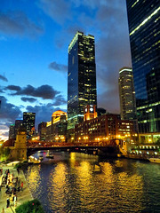 Chicago River, after dark, October 2016 (duaneschermerhorn) Tags: architecture architect chicago illinois buildings dark sky clouds river water bridge lights city cityscape colors colorful gold blue red building structure edifice people cafe tables