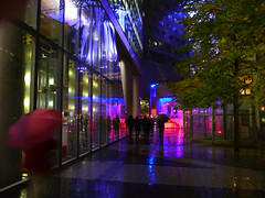 Sony centre Berlin at night (Sallyrango) Tags: city urban color berlin germany deutschland lights colours sonycentre sony rainy potsdamerplatz nights umbrellas festivaloflights pinkandblue pinksandpurples colourfullights urbanlighting