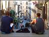 la pause...! (LILI 296... en hibernation) Tags: duo maison rue ville homme drapeau sicile catane canonpowershotg12 croisièremagiqueméditerranée