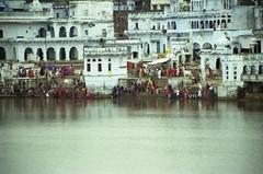 Pushkar Ghats 4 (marcwiz2012) Tags: people india architecture asia cityscape dress traditional scan stairway devotion local bathing pushkar hindu washing rajasthan traditionaldress localpeople