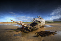 Bad Eddie Shipwreck (SJ Wray Photography) Tags: ocean county wood old blue ireland sea summer sky cloud sun seaweed detail building texture abandoned beach water weather canon lens landscape outdoors photography eos design daylight boat wooden seaside sand rust day colours angle bright shane wide bad sunny landmark tourist shipwreck filter sj eddie colourful popular 1022mm hdr donegal tyrone wray capsized gweedore strabane bunbeg 650d gnd4 blinkagain vision:mountain=057 vision:sunset=0624 vision:clouds=0969 vision:ocean=0577 vision:outdoor=0546 vision:sky=0975