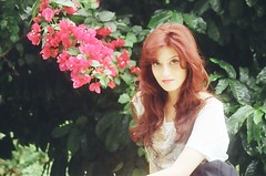 flower child (Clara P. N. Araujo) Tags: pink flowers portrait people film beauty fashion analog 35mm canon eos pastel redhead juliana 3000 kodakcolorplus clarapnaraujo claraaraujo {vision}:{people}=099 {vision}:{face}=099 {vision}:{plant}=0527 {vision}:{outdoor}=0698