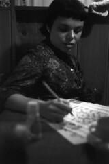 083759 18 (ndpa / s. lundeen, archivist) Tags: people blackandwhite bw woman film monochrome boston pencil 35mm blackwhite massachusetts nick august maggie 1950s beaconhill 1959 crosswordpuzzle dewolf nickdewolf photographbynickdewolf workingacrosswordpuzzle doingacrosswordpuzzle