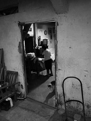 Never change (A.C.Elliott) Tags: door blackandwhite cat ecuador oldwoman curia ricohgxr flickrandroidapp:filter=none