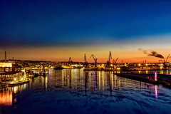 Urban Sunset (Cederquist Christoffer) Tags: sunset urban harbour long exposure tripod colors boats ships ship boat crane cranes smoke skyline cityscape gothenburg sweden bridge vantage point patterns pattern opera architecture beautiful church göteborg
