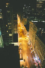 State Street At Night (vonderauvisuals) Tags: street urban chicago color eye lines birds sign vertical night contrast buildings grid photography lights long theater downtown mood cityscape view traffic post state empty famous perspective processing gods environment metropolis glowing tall feeling visuals straight hue tone correction chicagoist vonderau