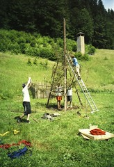 Building the bonfire (Joybot) Tags: wood camping summer camp holiday mountains building tree men green film 35mm fire countryside sticks lomo lca lomography woods europe bright guys burning bonfire romania trunk childrens ladder build campsite summercamp romanian 2007 construct constructing voronet youthcamp colorprint romnia colourprint childrenscamp vorone