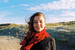 It's always like this (maggyvaneijk) Tags: blue winter portrait sky sun laura film beach wool smile clouds scarf 35mm hair sand friend wind pentax scheveningen dunes sandy knit windy analogue
