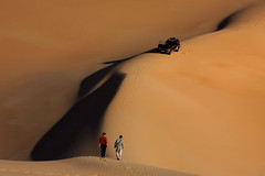 Bahariya Oasis safari or white desert tours Egypt (   ) Tags: africa two people hot male men sahara female town sand women desert adult hiking dune egypt middleeast transportation vehicle hiker recreation suv twopeople footprint landforms naturalworld northernafrica motorvehicle caucasianethnicity siwaoasis libyandesert matruhgovernorate