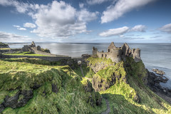 Dunluce Castle (Gareth Wray - 13 Million Views, Thank You) Tags: ocean county old bridge ireland windows sunset summer vacation irish cliff sun house holiday seascape building tree brick castle history abandoned tourism home field stone set architecture rural landscape photography nikon europe day photographer cows natural cloudy details famous hill scenic landmark visit tourist medieval historic atlantic national fox trust hd ni walls sight northern fortress gareth hdr grazing ruined portrush antrim coleraine wray dunluce strabane portballintrae tonemapped mcquillan 1024mm d5200 bestcapturesaoi elitegalleryaoi hdfox