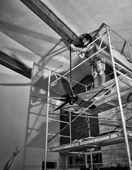 A Helping Hand (Anne Worner) Tags: blackandwhite woman work mono scaffolding arm candid humor highup portraitformat anneworner